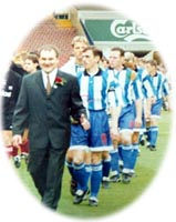 Dennis Underwood leads the team out at Wembley